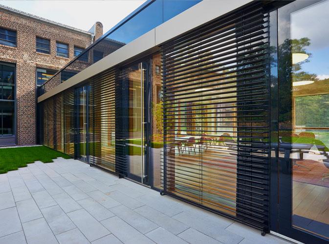 Aplicación de la revolución de la fachada ligera con el muro cortina 100% en madera en la sede de Enovos en Luxemburgo